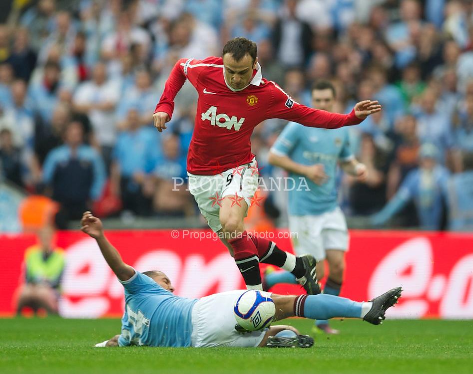 LONDON, ENGLAND - Saturday, April 16, 2011: Manchester United's Dimitar Berbatov and Manchester City's Vincent Kompany during the FA Cup Semi-Final match at Wembley Stadium. (Photo by David Rawcliffe/Propaganda)