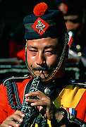 Man plays clarinet in Nepalese Army Band, Nepal
