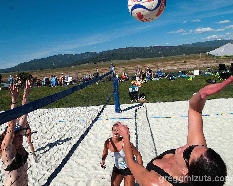 Debbie Pederson prepares to spike the ball during the Payette River Games beach volleyball competition at Kelly's Whitewater Park in Cascade, Idaho on June 21, 2014.