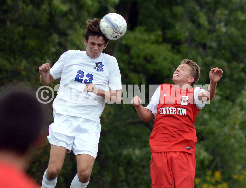 Central Bucks South's Jason Reinert #23 heads the soccer ball as Souderton's Ethan Bell #2 chases in the first half at Central Bucks South High School Monday September 21, 2015 in Warrington, Pennsylvania.   (Photo By William Thomas Cain)
