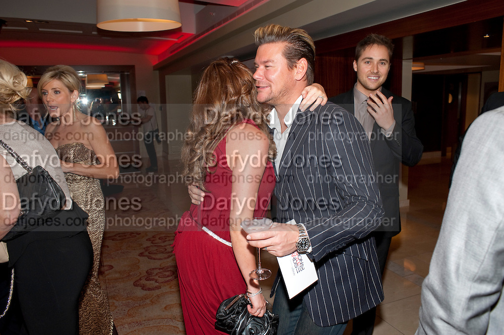 MICHELLE HEATON; PHILIP TURNER, London Lifestyle Awards. Riverbank Park Plaza. London.6 October 2011. <br /> <br />  , -DO NOT ARCHIVE-&copy; Copyright Photograph by Dafydd Jones. 248 Clapham Rd. London SW9 0PZ. Tel 0207 820 0771. www.dafjones.com.