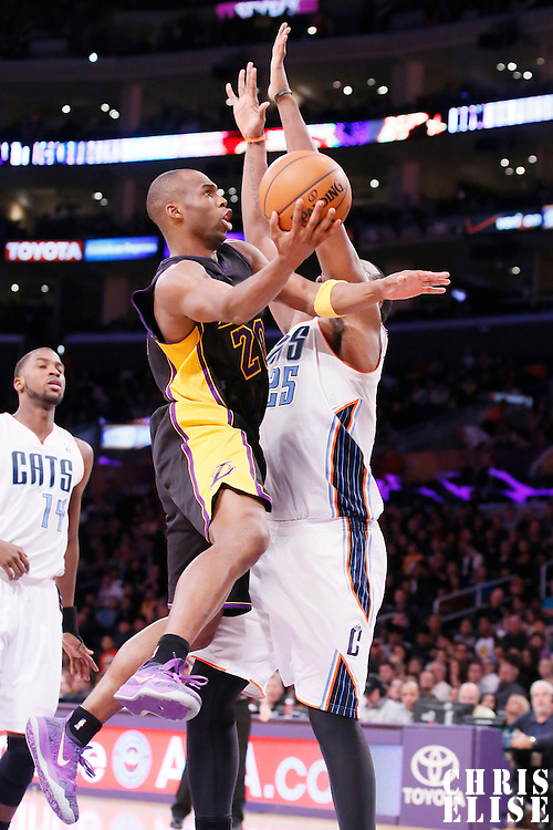 31 January 2014: Los Angeles Lakers shooting guard Jodie Meeks (20) goes for the layup against Charlotte Bobcats center Al Jefferson (25) during the Charlotte Bobcats 110-100 victory over the Los Angeles Lakers at the Staples Center, Los Angeles, California, USA.