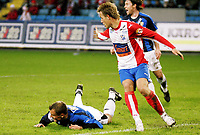 Fotball , 30. april 2006, Tippeligaen Eliteserien , FC Lyn Oslo - Stabæk , Tom Stenvoll har blitt felt av Kristian Flittie Onstad og får straffe . Bak roper Veigar Pall Gunnarsson Foto: Kasper Wikestad