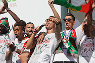 The portuguese team captain Cristiano Ronaldo and other portuguese football players singing with the crowd of portuguese supporters at Alameda Dom Afonso Henriques, in Lisbon. Portugal's national squad won the Euro Cup the day before, beating in the final France, the organizing country of the European Football Championship, in a match that ended 1-0 after extra-time.