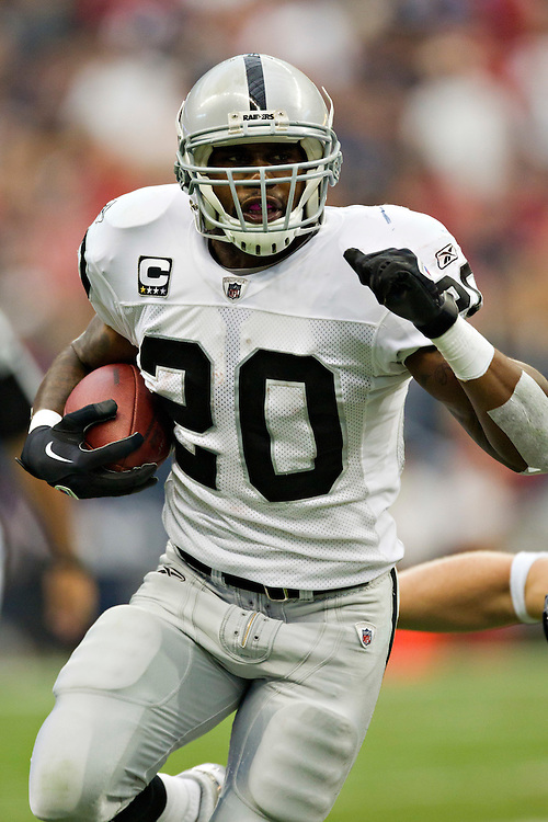 HOUSTON, TX - OCTOBER 9:   Darren McFadden #20 of the Oakland Raiders runs the ball against the Houston Texans at Reliant Stadium on October 9, 2011 in Houston, Texas.  The Raiders defeated the Texans 25 to 20.  (Photo by Wesley Hitt/Getty Images) *** Local Caption *** Darren McFadden