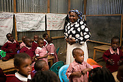Mama Nduko is the class teacher looking after the 2 - 3 year old children.