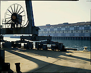 Old Finger Wharf and crane Woolloomooloo Sydney,Landscape photography by Paul Green,Historic,The Sydney Harbour Trust built the Finger Wharf, or Woolloomooloo Wharf, between 1911 and 1915 with the charter to bring order to Sydney Harbour's foreshore facilities. The wharf became the largest wooden structure in the world. The areas commerce was dominated by shipping at the wharf,English Colonial Architecture 20th century,exhibition image