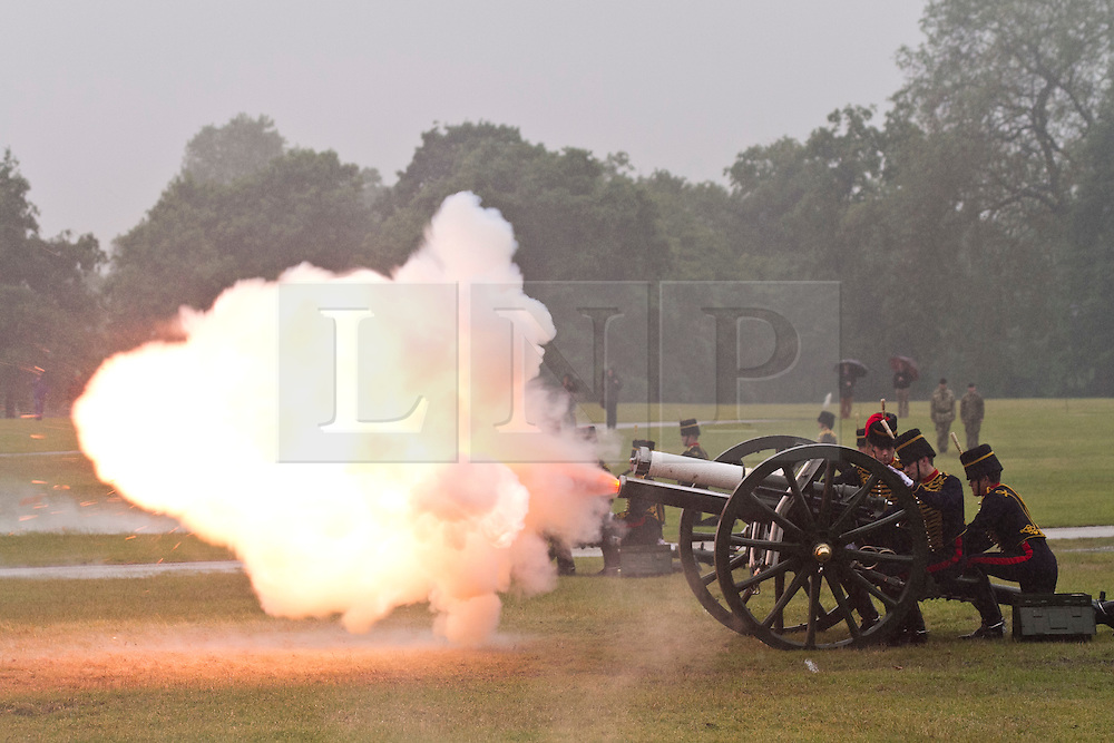 © Licensed to London News Pictures. 11/06/2012. London, UK. A 41 gun salute is fired by the King's Troop Royal Horse Artillery through heavy rain in Hyde Park today (11/06/12) to mark the Duke of Edinburgh's 91st birthday which was yesterday (10/06). Prince Phillip left hospital just before his birthday after suffering from a bladder infection over the Queen's Diamond Jubilee weekend. Photo credit :James Gourley/LNP.
