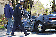 LEVITTOWN, PA - APRIL 17:  Investigators survey the accident scene April 17, 2014 in Levittown, Pennsylvania. An 85-year-old man was killed when a cement truck collided with his vehicle. (Photo by William Thomas Cain/Cain Images)