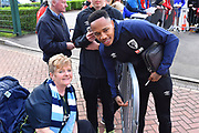 Nathaniel Clyne (23) of AFC Bournemouth has a photo with a fan as he arrives at the Vitality Stadium before the Premier League match between Bournemouth and Manchester City at the Vitality Stadium, Bournemouth, England on 2 March 2019.