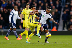Saido Berahino of West Brom is challenged by Paulinho of Tottenham Hotspur - Photo mandatory by-line: Rogan Thomson/JMP - 07966 386802 - 31/01/2015 - SPORT - FOOTBALL - West Bromwich, England - The Hawthorns - West Bromwich Albion v Tottenham Hotspur - Barclays Premier League.