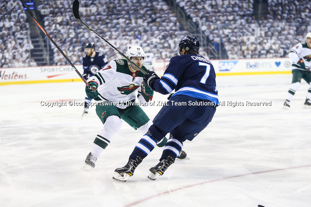 WINNIPEG, MB – April 11: Winnipeg Jets defenseman Ben Chiarot (7) checks Minnesota Wild forward Marcus Foligno (17) during the Stanley Cup Playoffs First Round Game 1 between the Winnipeg Jets and the Minnesota Wild on April 11, 2018 at the Bell MTS Place in Winnipeg MB. (Photo by Terrence Lee/Icon Sportswire)