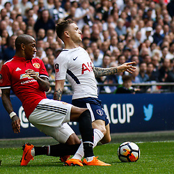 Kieran Trippier of Tottenham Hotspur is tackled by Ashley Young of Manchester United during the Emirates FA Cup match between Manchester United and Tottenham Hotspur at Old Trafford on April 21, 2018 in Manchester, England. (Photo by Rob Sambles)