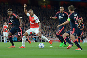 Arsenal striker Theo Walcott attempts to turn Bayern Munich defender David Alaba during the Champions League  Group F match between Arsenal and Bayern Munich at the Emirates Stadium, London, England on 20 October 2015. Photo by Alan Franklin.