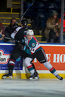 KELOWNA, CANADA - MARCH 7: Wil Kushniryk #14 of the Kelowna Rockets checks Cyle McNabb #12 of the Vancouver Giants into the boards  on March 7, 2018 at Prospera Place in Kelowna, British Columbia, Canada.  (Photo by Marissa Baecker/Shoot the Breeze)  *** Local Caption ***