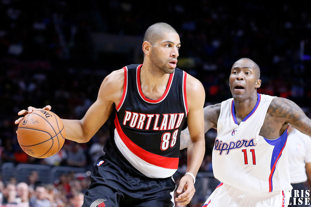 08 November 2014: Portland Trail Blazers forward Nicolas Batum (88) drives past Los Angeles Clippers guard Jamal Crawford (11) during the Los Angeles Clippers 106-102 victory over the Portland Trail Blazers, at the Staples Center, Los Angeles, California, USA.