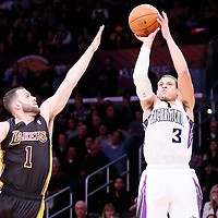 28 February 2014: Sacramento Kings point guard Ray McCallum (3) takes a jumpshot over Los Angeles Lakers point guard Jordan Farmar (1) during the Los Angeles Lakers 126-122 victory over the Sacramento Kings at the Staples Center, Los Angeles, California, USA.