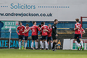 The York City players celebrate as Jon Parkin (York City) scores York City's first goal of the game to make it 1-0 to the home team during the Vanarama National League match between York City and Wrexham FC at Bootham Crescent, York, England on 17 April 2017. Photo by Mark P Doherty.