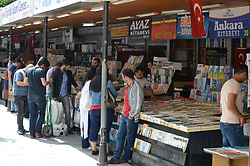 June 10, 2017 - Ankara, Turkey - People look at books in front of bookshops at Olgunlar Street in Ankara, Turkey on June 10, 2017. The street, which locates in the city centre, is known for its iconic booksellers, and selling illegally printed books since the late-1980s. In the 1990s, shops were selling different kinds of anthologies, comics books, foreign language magazines, and vinyl records, but shops have started selling test books for high school and university students since the 2000s as some people claim that the street loses its historical significance. (Credit Image: © Altan Gocher/NurPhoto via ZUMA Press)