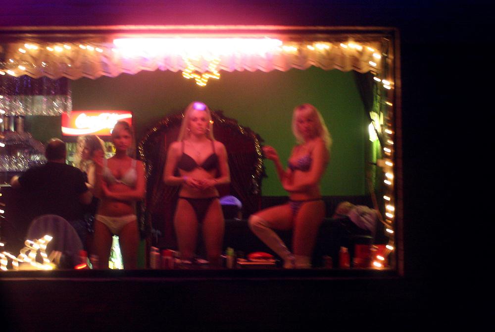 Dubi/Tschechische Republik, CZE, 14.12.06: Prostituierte bieten Ihre Dienste in einem Bordell an der E-55 in der Stadt Dubi (Eichwald) an - Dubi liegt etwa f&uuml;nf Kilometer.n&ouml;rdlich von Teplice direkt an der E55. Einst ein respektierter Kurort, ist die Kleinstadt in den vergangenen 15 Jahren zu einem Eldorado des Sextourismus geworden. <br /> <br /> Dubi/Czech Republic, CZE, 14.12.06: Prostitutes offering their service in a brothel in Dubi at the E-55 highway. Dubi is located five kilometer north from the city of Teplice.