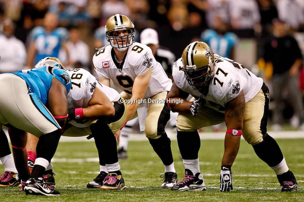 October 3, 2010; New Orleans, LA, USA; New Orleans Saints quarterback Drew Brees (9) under center during a game against the Carolina Panthers at the Louisiana Superdome. The Saints defeated the Panthers 16-14. Mandatory Credit: Derick E. Hingle