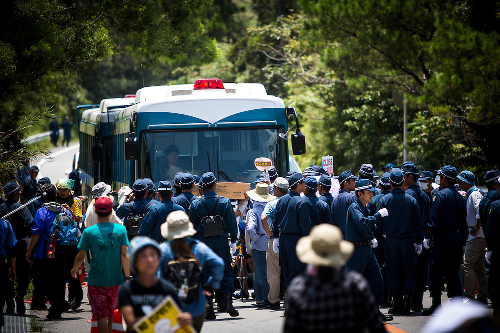 OKINAWA, JAPAN - AUGUST 19 : Hundred additional police from Osaka were deploy to guard the construction trucks from Anti U.S base protesters as they staged a sit-in protest against the construction of helipads in front of the gate of U.S. military's Northern Training Area in the village of Higashi, Okinawa Prefecture, on August 19, 2016. Japanese government resume construction of total six helipads in a fragile ten million year old Yanbaru forest that is home to endemic endangered species such as the Okinawan rail and Okinawan wood pecker. (Photo by Richard Atrero de Guzman/NURPhoto)