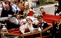 File photo dated 29/07/81 of the Prince of Wales and his bride, the Princess of Wales, making their way to Buckingham Palace in an open-top carriage after their wedding ceremony at St. Paul's Cathedral in London.
