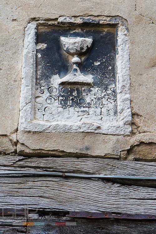 Emblem embedded in wall over a door in Jesi.
