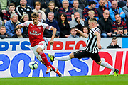 Nacho Monreal (#18) of Arsenal drags the ball away from the challenge of Matt Ritchie (#11) of Newcastle United during the Premier League match between Newcastle United and Arsenal at St. James's Park, Newcastle, England on 15 September 2018.