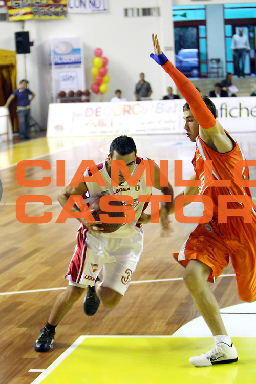 DESCRIZIONE : Barcellona Pozzo di Gotto Campionato Lega Basket A2 2010-11 Sigma Barcellona Snaidero Udine<br /> GIOCATORE : Michele CARDINALI<br /> SQUADRA : Sigma Barcellona<br /> EVENTO : Campionato Lega Basket A2 2010-2011<br /> GARA : Sigma Barcellona Snaidero Udine<br /> DATA : 03/10/2010<br /> CATEGORIA : Penetrazione<br /> SPORT : Pallacanestro <br /> AUTORE : Agenzia Ciamillo-Castoria/G.Pappalardo<br /> Galleria : Lega Basket A2 2009-2010 <br /> Fotonotizia : Barcellona Pozzo di Gotto Campionato Lega Basket A2 2010-11 Sigma Barcellona Snaidero Udine<br /> Predefinita :