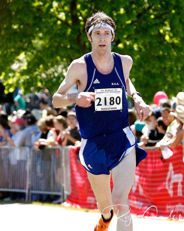 Roger Crowley/Times Argus.Ben Schersten finishes the 20th Annual KeyBank Vermont City Marathon Sunday in Burlington.