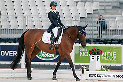 Sara Morganti riding Royal Delight in the Grade 1a Para-Dressage at the 2014 World Equestrian Games, Caen, Normandy, France..