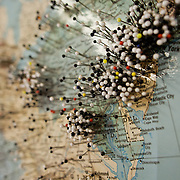 Pins mark places on a map of the United States.