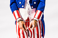 A closeup of a Uncle Sam character in handcuffs. A conceptual shot depicting government corruption.