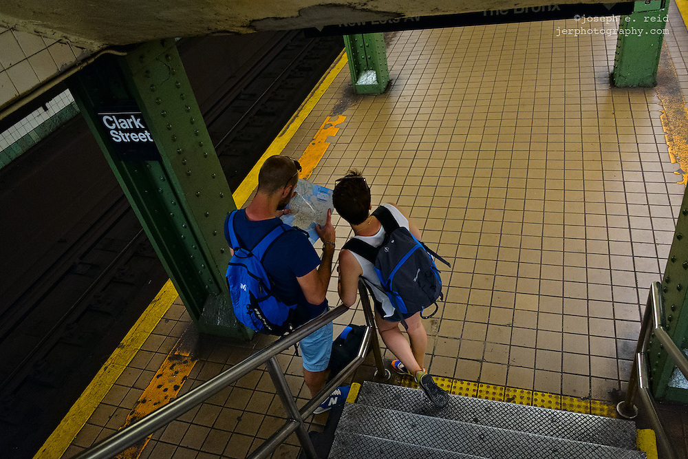 Couple looking at subway map, Brooklyn, NY, US