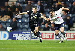Peterborough United's Conor Washington in action with Preston North End's Bailey Wright - Photo mandatory by-line: Joe Dent/JMP - Mobile: 07966 386802 - 17/03/2015 - SPORT - Football - Preston - Deepdale - Preston North End v Peterborough United - Sky Bet League One