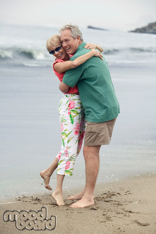 Middle-Aged Couple Hugging on Beach