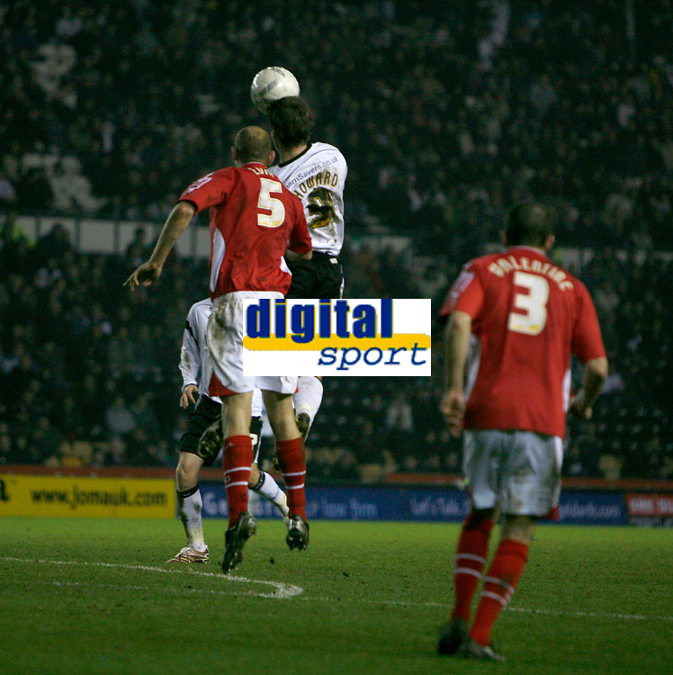 Steve Howard (derby County, white) in an aeriel challange with Steve Evans (red) of Wrexham