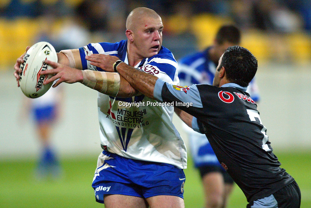 16 April 2004, Westpac Stadium Wellington, New Zealand, NRL New Zealand Warriors vs Canterbury Bulldogs.<br />Bulldog's Mark O'Meley looks to pass while under pressure from Warriors captain Stacey Jones during the Bulldog's 24-18 win over the Warriors on Friday night.<br />Please Credit:Marty Melville/Photosport