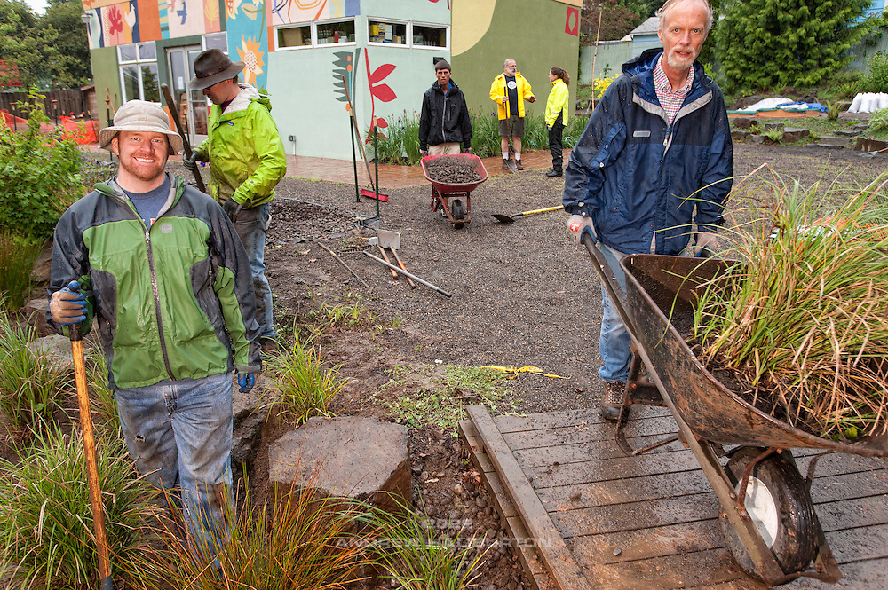 Tyson Leggate, Josh Lighthipe and Gary Riggs volunteer at the rain garden work meet, Café au Play at Tabor Commons, a project of the Southeast Uplift Neighborhood Coalition (SEUL) and volunteers from Portland's Mt Tabor neighborhood.
