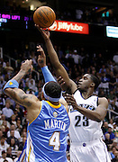 Utah Jazz guard Wesley Matthews (23) scores over Denver Nuggets forward Kenyon Martin (4) during the second half of Game 6 of the NBA Western Conference first-round playoff series in Salt Lake City, Friday, April 30, 2010. Matthews scored 23 points in the Jazz 112-104 win. (AP Photo/Colin E Braley)