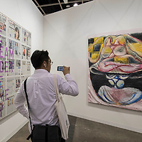 Visitor takes a photo of artist Gerasimos Floratos's 'Official pink taxi mind, 2017' (R) at Art Basel Hong Kong 2017 on 23 March 2017, in Hong Kong Convention and Exhibition Centre, Hong Kong, China. Photo by Chris Wong / studioEAST