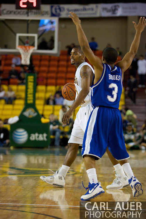 November 26, 2008: University of Alaska-Anchorage guard Lonnie Ridgeway runs the offense against Hampton guard Rashad West (3)in the opening game of the 2008 Great Alaska Shootout at the Sullivan Arena against the University of Alaska-Anchorage Seawolves.