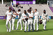 Surrey Win - The Surrey players walk off the field after beating Hampshire by an innings and 58 runs during the Specsavers County Champ Div 1 match between Hampshire County Cricket Club and Surrey County Cricket Club at the Ageas Bowl, Southampton, United Kingdom on 11 June 2018. Picture by Graham Hunt.