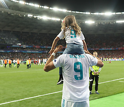 May 26, 2018 - Kiev, Ukraine - Karim Benzema of Real Madrid with his doughter celebrate winning the UEFA Champions League final between Real Madrid and Liverpool at NSC Olimpiyskiy Stadium on May 26, 2018 in Kiev, Ukraine. (Credit Image: © Raddad Jebarah/NurPhoto via ZUMA Press)