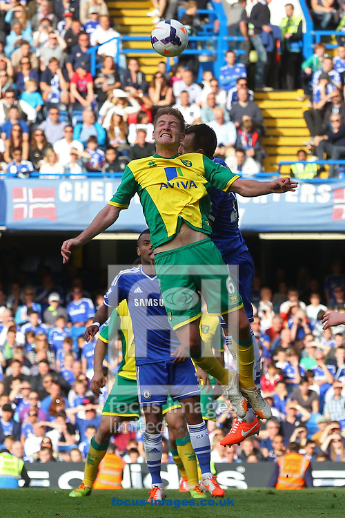 Michael Turner of Norwich and John Terry of Chelsea in action during the Barclays Premier League match at Stamford Bridge, London<br /> Picture by Paul Chesterton/Focus Images Ltd +44 7904 640267<br /> 04/05/2014