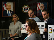 "31 OCTOBER 2019 - DES MOINES, IOWA: EMILY HOLLEY, Executive Director of Iowa Voices, speaks out against a recent healthcare vote in the US Senate during a protest at the Neil Smith Federal Building in Des Moines. A small crowd of people came to the federal building, where US Senators Chuck Grassley's (R-IA) and Joni Ernst's (R-IA) offices are, to deliver a petition protesting the Senate's vote that critics say would allow ""spooky junk health insurance plans"" with limited coverage and would allow insurance companies to deny coverage to people with pre-existing conditions.           PHOTO BY JACK KURTZ"