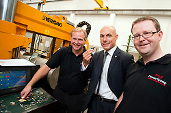 Premier League Referee Howard Webb MBE (centre)  blows kick off whistle to mark the start of production at  Premier Hytemp Ltd new facility on Thorncliffe Industrial Estate Sheffield. Pressing the start button is Premier Hytemp Group Managing Director Donald Wilson (left) and Group Financial Director Will Gold (right).22nd September2011 Image © Paul David Drabble