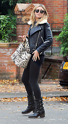 Model Abbey Clancy and footballer husband Peter Crouch out and about in London, UK. 21/10/2014<br /> BYLINE MUST READ : GOTCHAIMAGES.COM<br /> <br /> Copyright by © Gotcha Images Ltd. All rights reserved.<br /> Usage of this image is conditional upon the acceptance <br /> of Gotcha Images Ltd, terms and conditions available at<br /> www.gotchaimages.com