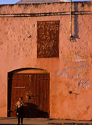 Man Standing In Front Of Building, Mexico